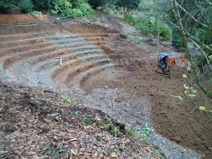 A smaller digger is used to carve out the terraces of the amphitheatre at Trebah Garden, Cornwall. Dec 12