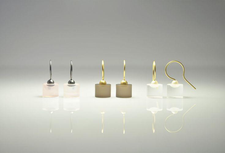 <em>Dive</em> earrings. Gemstone with silver, gemstone with 750 yellow gold, gemstone with 750 yellow gold and Akoya pearl