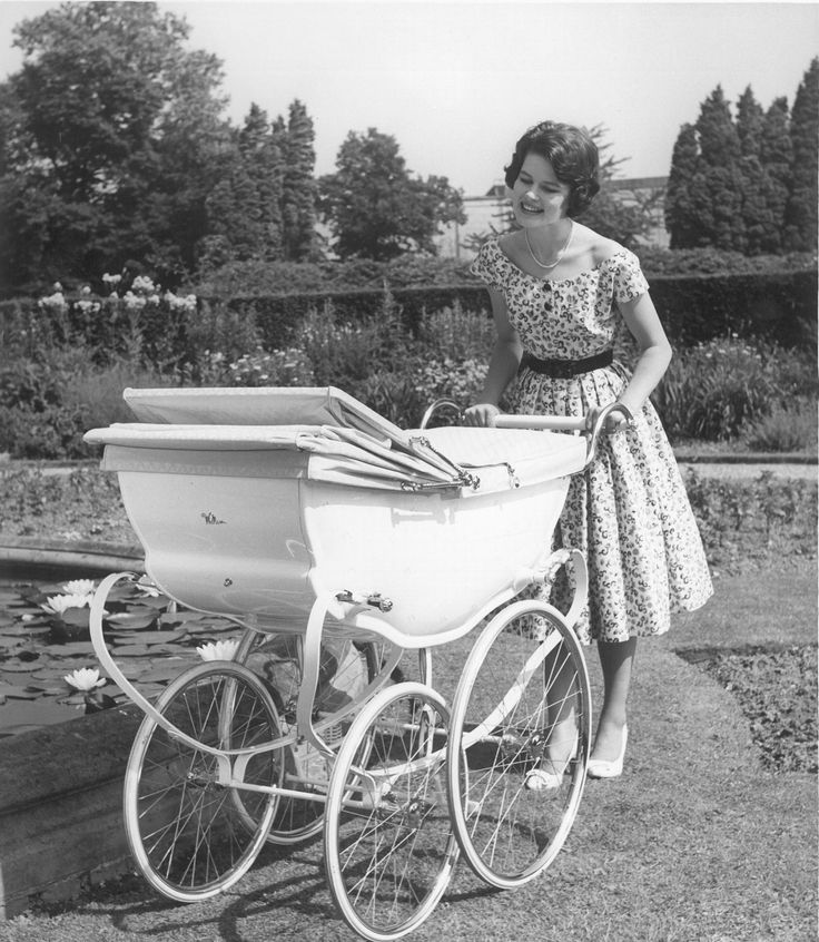 This beautiful photograph was taken in 1963 and shows the magnificent Wilson Pastorale, a lovely coach pram decorated with sprays of hand-painted pink and blue flowers