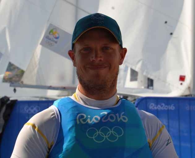 I can't wipe the grin from my face. Tom Burton after winning Olympic Gold. Photo Roger McMillan.