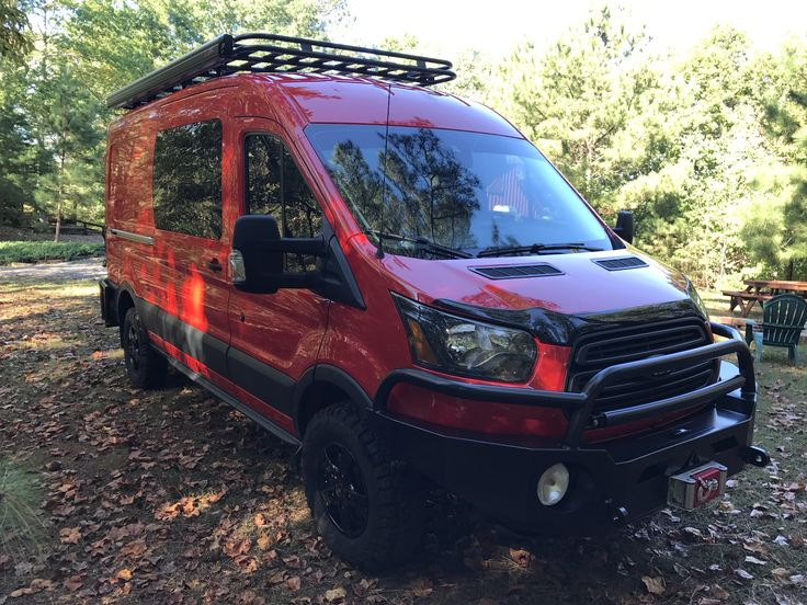 Ford Transit with Aluminess front bumper, rear bumper with tire and box swing arms, ladder and roof rack!