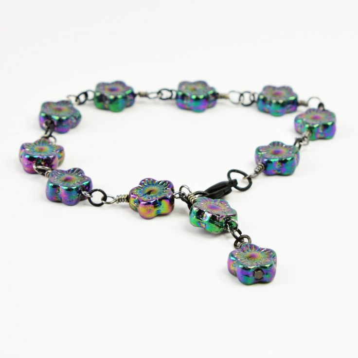 You'll be pretty in black wearing this iridescent floral Czech pressed glass link bracelet. Or give it to your favorite goth girl. A Victorian-style bracelet, it closes at 7 inches with a black lobster clasp, but it can be extended by half-inch increments