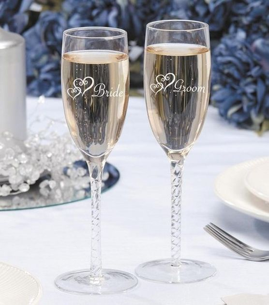 Darice® 2 pk. Bride & Groom Twisted Champagne Glasses & Wedding Day Accessories at Joann.com $15.99