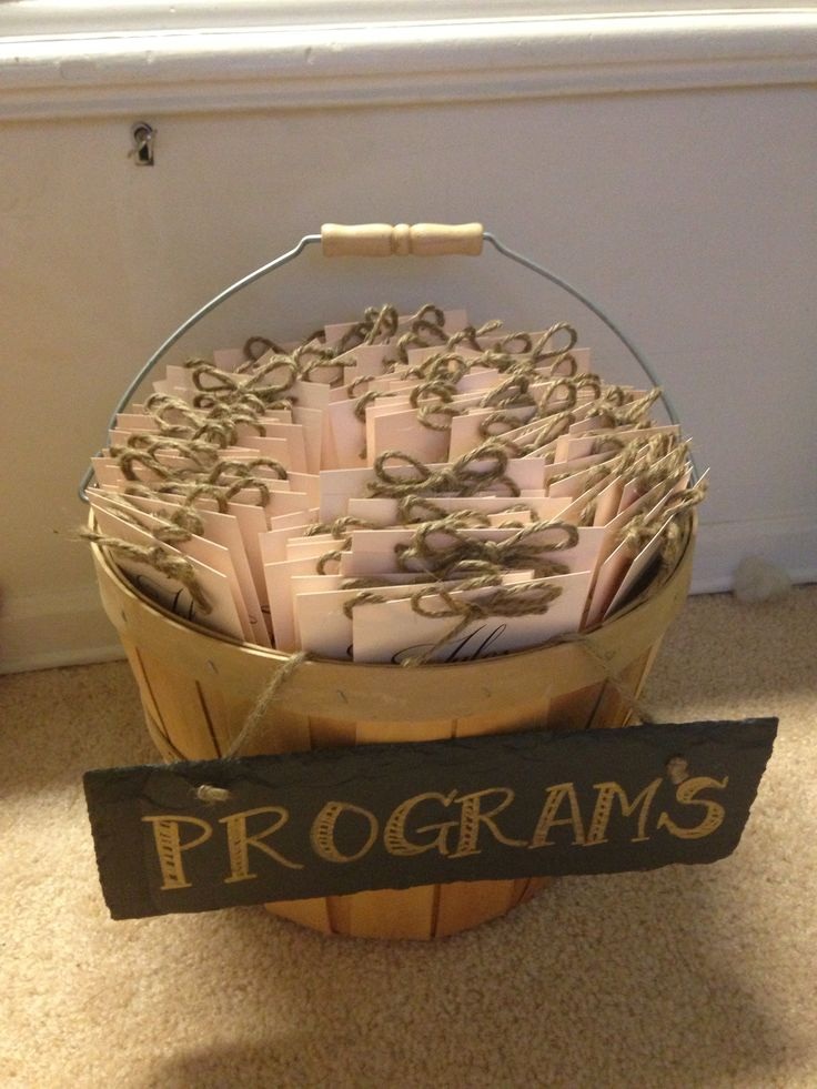 Homemade Wedding Programs in an apple basket. Uses for bushel baskets.