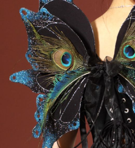 Embellish store bought wings with peacock feathers (or flowers, leaves, trim, ribbon, glitter and more)!  Halloween next year?