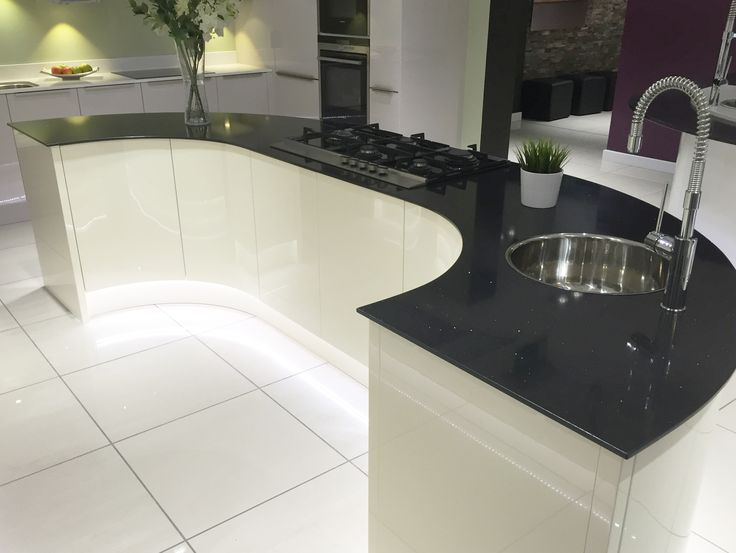 Modern kitchen island design in gloss ivory with large