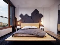 A wooden platform bed with a creative headboard makes for the perfect retreat.