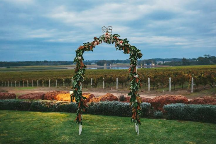 Flower arch by Scentiment Flowers, photography by Bianca Kate Photography, stunning view from Watershed Winery Margaret River