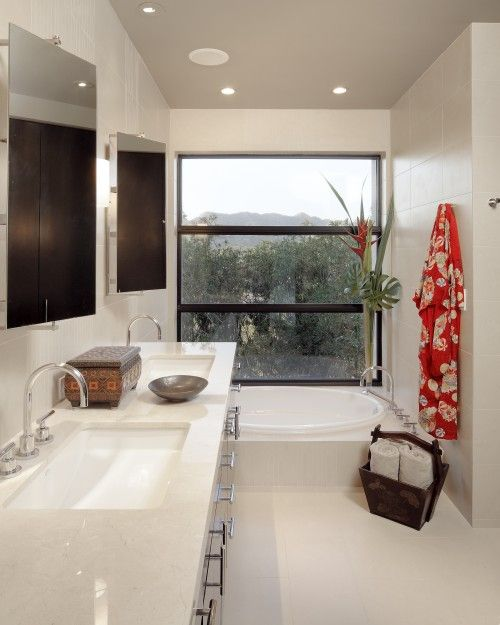 placement of tub. ALSO oval tub and rectangle sinks....see it can be done, silly sales people!