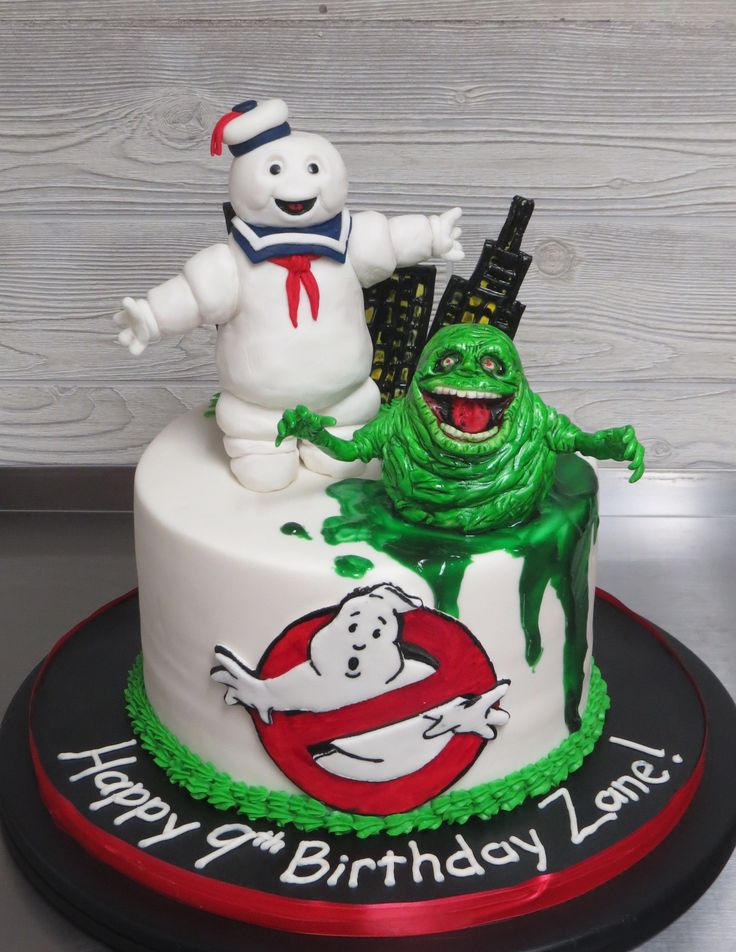 Ghostbusters CAKE!  Everything on this cake was handmade and edible - Stay-Puff Marshmallow Man and Slimer were sculpted out of cereal treats and decorated with fondant!