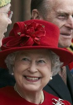 My favorite picture of Queen Elizabeth II The Christmas Red looks stunning on her and that smile, you can't buy that. Truly a happy Queen