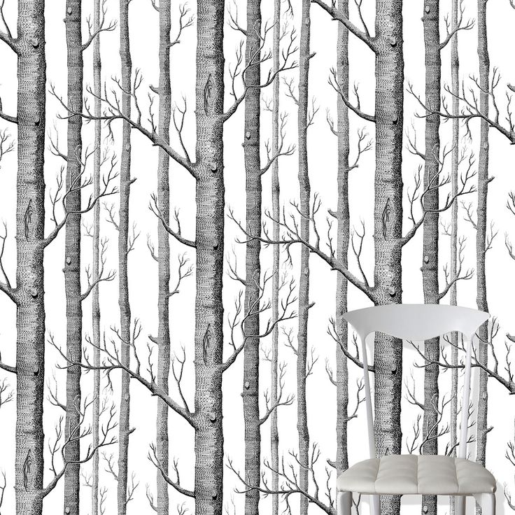 Originally designed as a screen print, the Woods wallpaper pattern features bold sketches of trees .