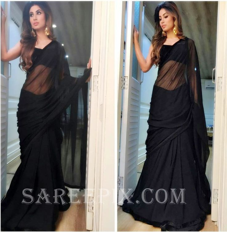 Hindi serial diva Mouni roy in black transparent saree. She looks eye catchy in saree with sleeveless matching blouse. Curly free hairstyle and ear rings f