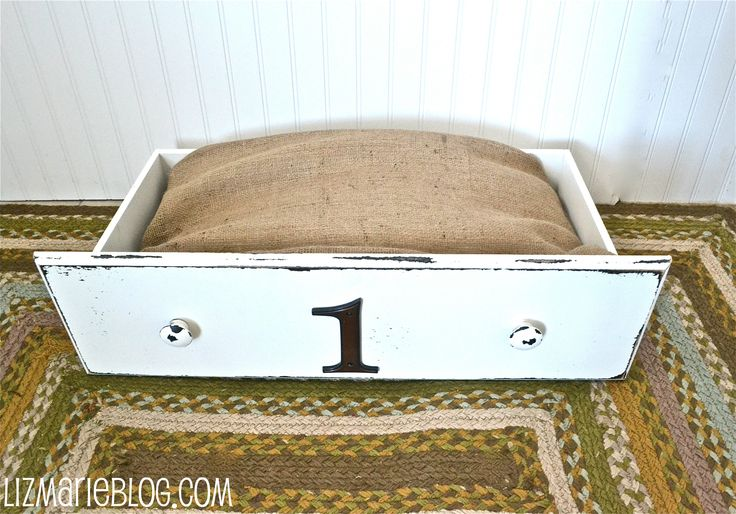 Recycled drawer dog bed, put anything on the front... a number, their name, paw prints, etc