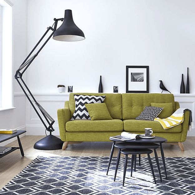 black and white living room with lime green sofa, chartreuse, pantone golden lime, black and white prints