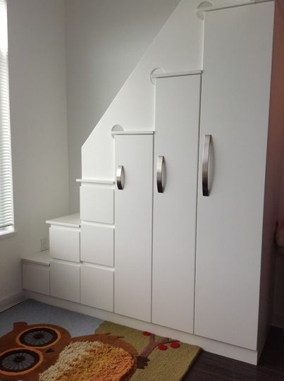 Maximized space with loft bed over closets.