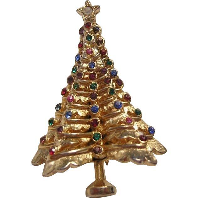 1970's 3D Dimensional RHINESTONES Colorful Christmas Tree Pin.  https://www.pinterest.com/clarasjewelry/christmas-on-ruby-lane/