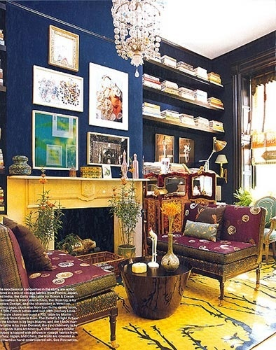 Whoa!  I love the dark blue walls contrasting with the mustard mantelpiece, and the floating bookshelves.  Beautiful space.