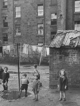 Children Playing on Slum Street in the City
