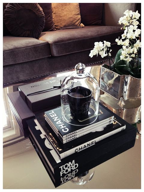 Styled coffee table - stacked books. flowers and other decor. chic. home styling ideas. home styling inspo
