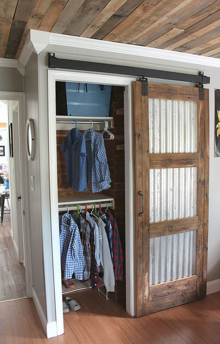 Cool sliding barn door made from reclaimed wood, corrugated tin and salvaged hardware. By Maple Leaves & Sycamore Trees.