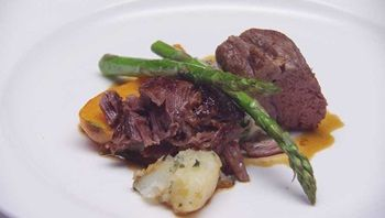 Slow Cooked Lamb in Cumin Jus with Asparagus en Papillote, Carrots and Potatoes