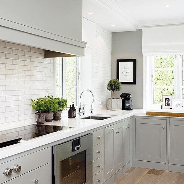 A soft gray & white color combo makes a beautiful space in this kitchen design by @collinedesign