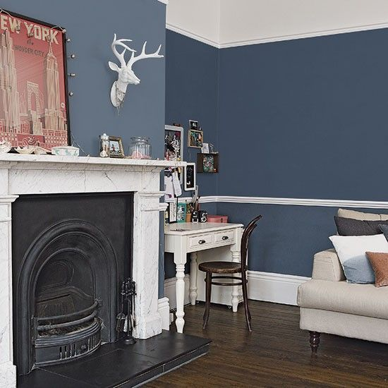stone + black fireplace + dark blue walls