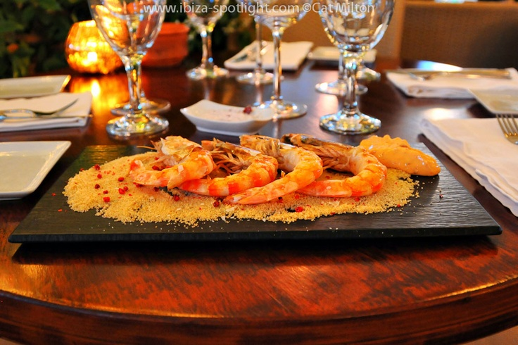 Grilled king prawns on 'sand' served with rose harissa mayonnaise