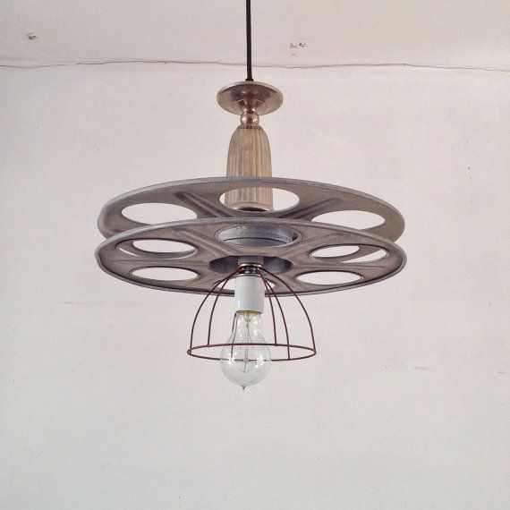 Industrial Chandelier  Film Reel Media Room Vintage by industrial lightworks.  This piece just sold.
