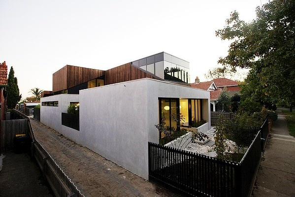 Wedge shapes reference the pitched roof lines of the suburb, and elegant geometric forms create visual interest inside.