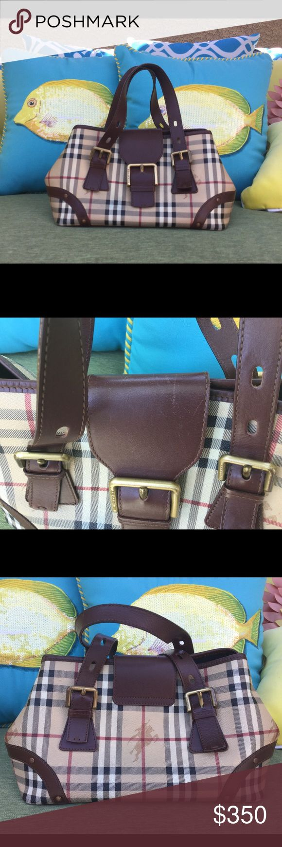 ♥️Burberry classic Haymarket check bag 💯 Crafted from Burberry's Iconic Haymarket check patterned canvas,the exterior features contrasting brown leather handles.It is Secured with flap with gold tone buckles. Interior lining black Fabric & has zip pocket. Used wear on hardware see pictures. No stain or ink.top of flap has scratches in between the handles not noticeable. Price reflects flaws 💯Authentic medium bag  12 wide 7 1/2 tall must Have Burberry Bags Satchels