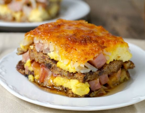 Breakfast Lasagna has layers of french toast, hash browns, smoked ham, sausage, and eggs!