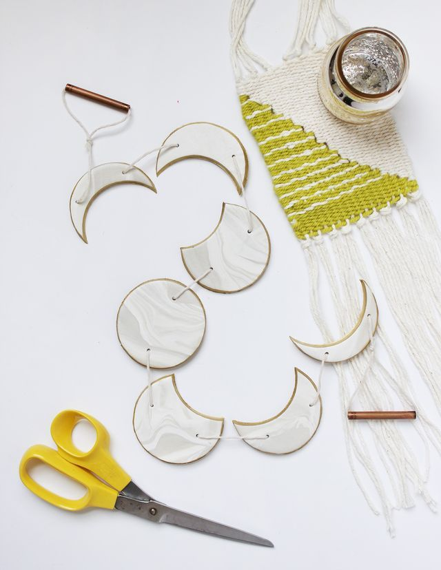 Create your own phases of the moon garden with oven bake clay. Get the full tutorial on www.ABeautifulMess.com