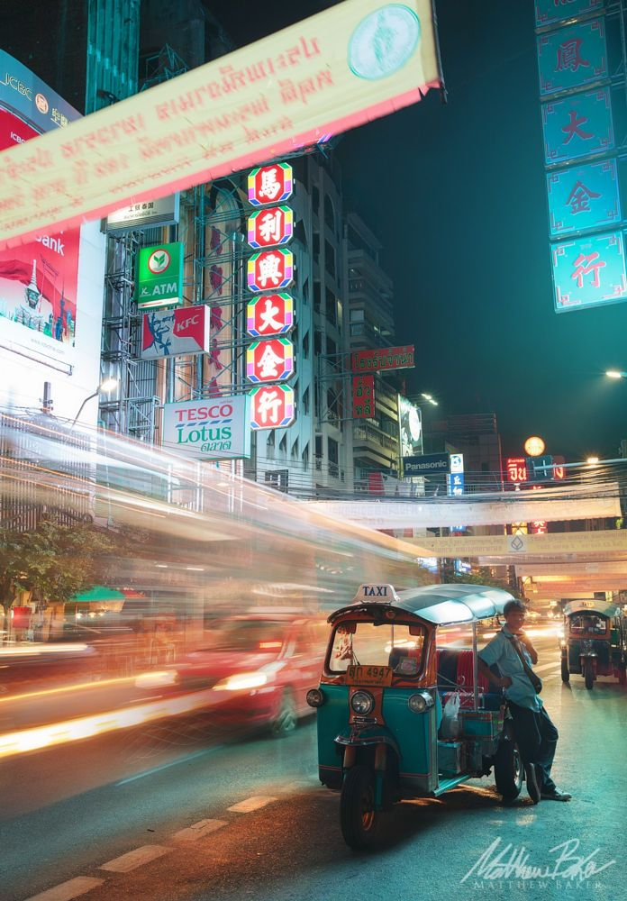 A Tuk-Tuk driver taking a break - Chinatown in Bangkok, Thailand.