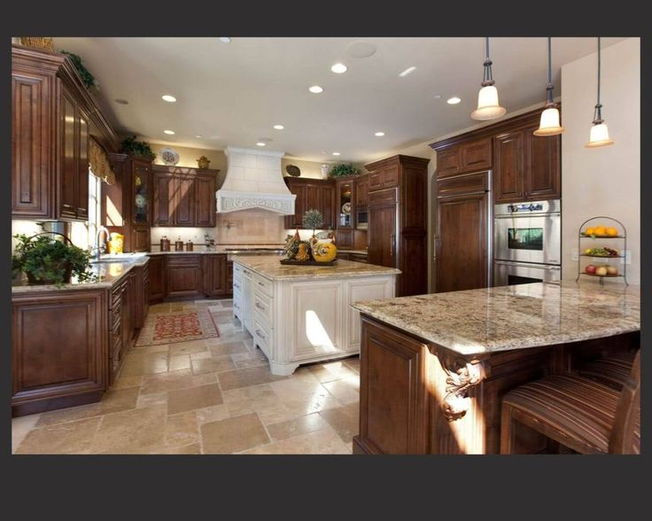 Richly Detailed U Shaped Kitchen Centers Dark Wood Cabinetry Around Large,  White Painted Wood