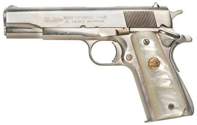 1911 with pearl grips and a nickle plate finish. 45.Caliber