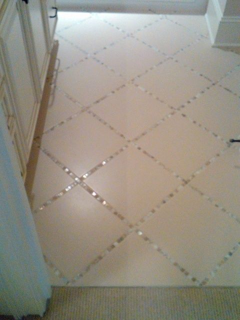 Lay a thin strip of mosaic tile in between the large tiles, instead of just using grout. pretty!