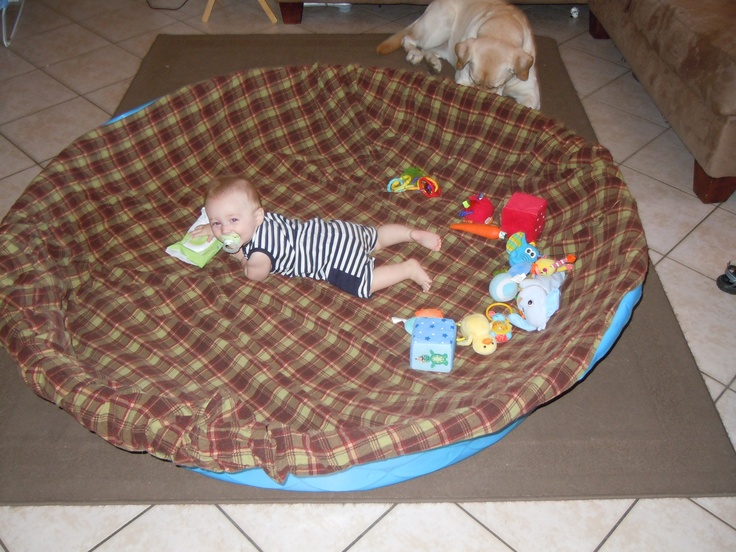Create a safe play area (and containment unit) for your crawler using a plastic baby pool and blankets/ sheets.