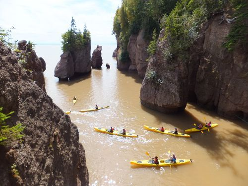 Exploring the Bay of Fundy at Hopewell Rocks, Canada. AMAZING kayaking here with unparalleled views. #bayoffundy