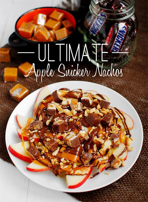 Ultimate Apple Snicker Nachos ~ start with a layer of fresh apple slices  topped with gooey melted caramel, a silky chocolate drizzle, crunchy peanuts, and chopped Snickers. Easier to eat than a Carmel Apple on a stick!