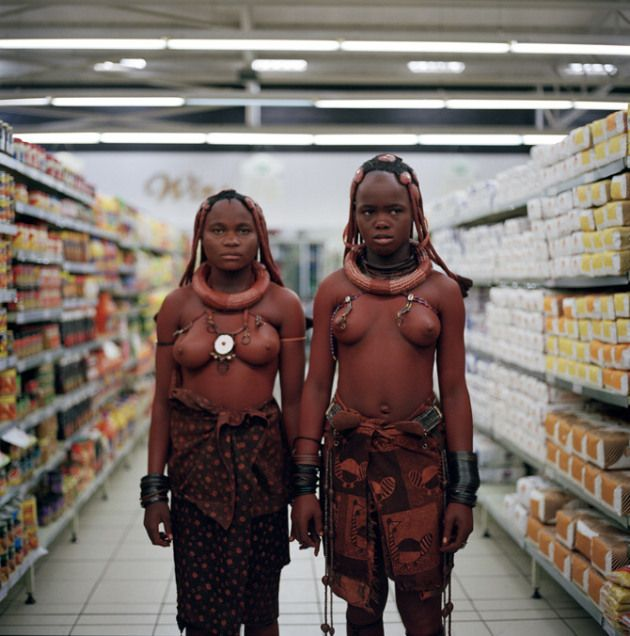 Two women from the Himba tribe shopping at a supermarket in Swakopmund, Namibia, image by London based creative director Toufic Beyhum.    toufic-beyhum HIMBA