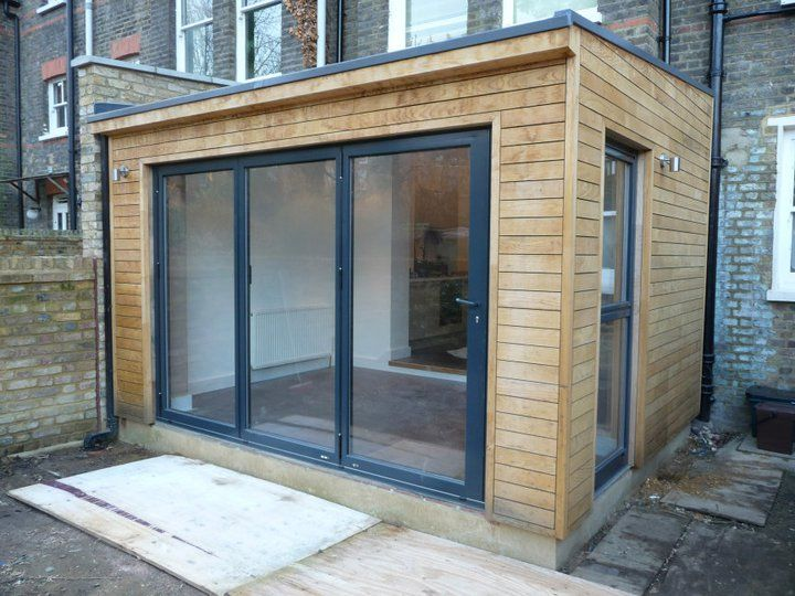 The wooden cladding, bifold doors and skylights = exactly what we want at the back of our house, but at least twice the width and depth with a kitchen to one side.