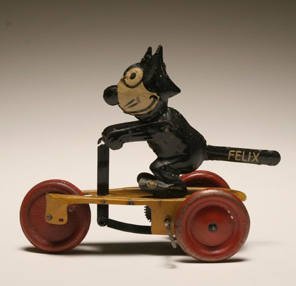 """Vintage Felix the Cat tin litho wind up; 1924 copyright mark, SG Made in Germany. 7""""L. Good working condition, minor wear."""