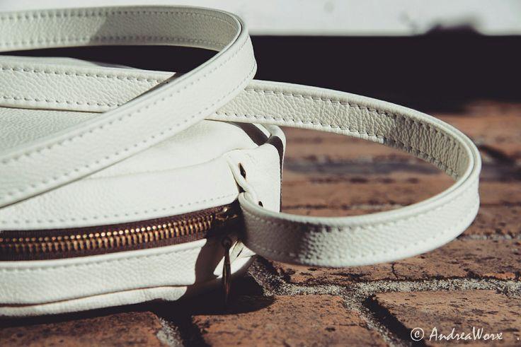 AndreaWorx unique round white leather handbag