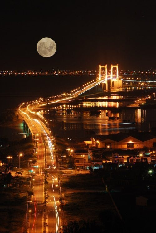 The moon and a beautiful bridge with twinkling lights; from thechive.com