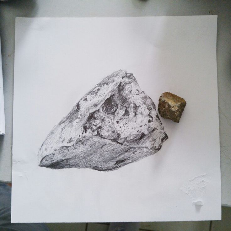 A drawing of a rock using 2B and 4B pencils to emphasize the depth and the texture of the rock's surface.