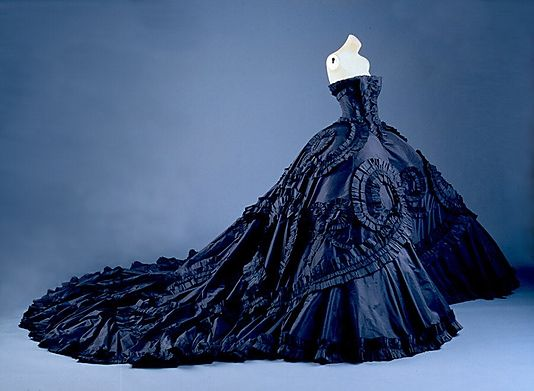 Maria-Luisa (dite Coré)  House of Dior  (French, founded 1947) Designer:      John Galliano Date: spring/summer 1998  Culture:French  Medium: (a, e, f) silk; (b, d) synthetic; (c) wool; (g, h) metal, glass  Dimensions:Length (b; greatest): 50 in. (127 cm) Height (c): 13 3/8 in. (34 cm) Length (d): 14 in. (35.6 cm) Heel to Toe (e,f): 9 1/2 in. (24.1 cm) Length (g,h): 2 in. (5.1 cm) Gift of Christian Dior Couture Paris, 1999