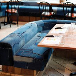 London Brazilian restaurant chain Cabana uses reject and recycled jeans as banquette covering in its St Giles site. The covering is made by a favela collective of women called Recicla Jeans.