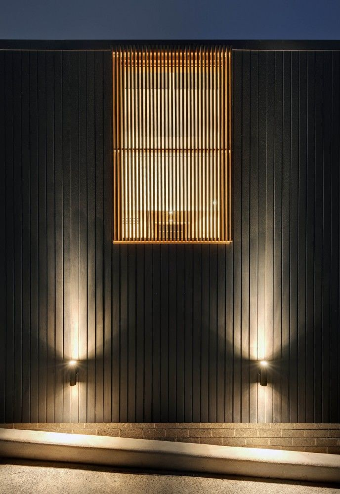 feature wooden louvre window + facade lights